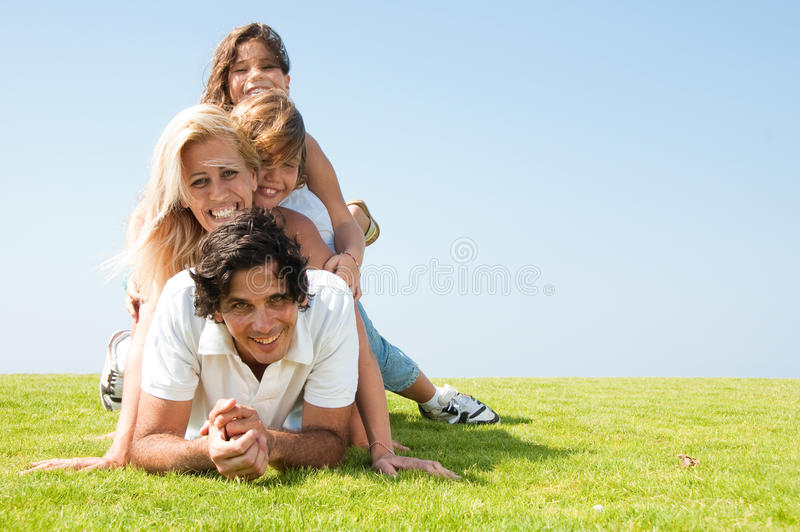 Family on meadow stock photo