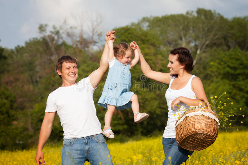 Family on the meadow stock photo