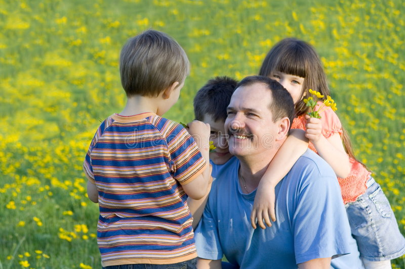 Family on the meadow royalty free stock photo