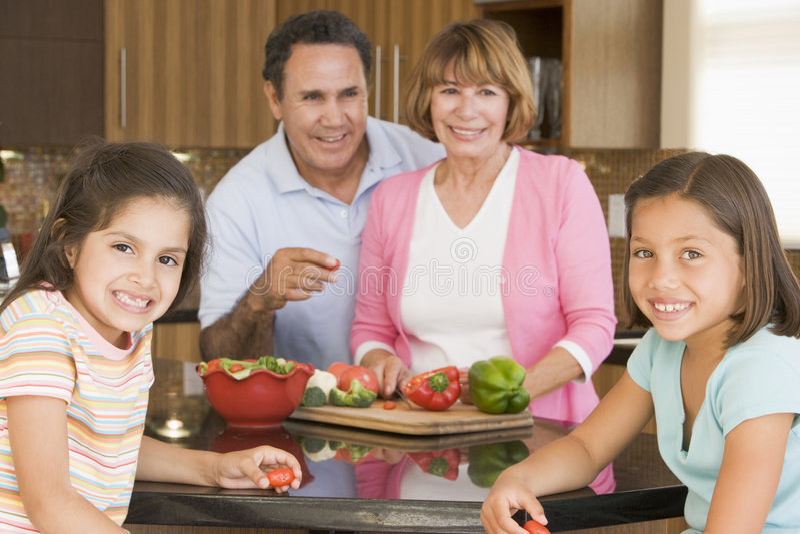 family meal preparing together στοκ φωτογραφία