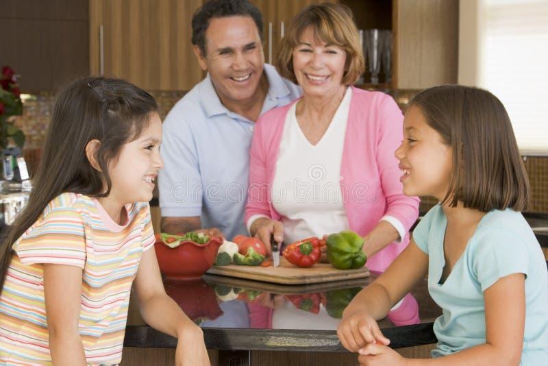 family meal preparing together στοκ εικόνα