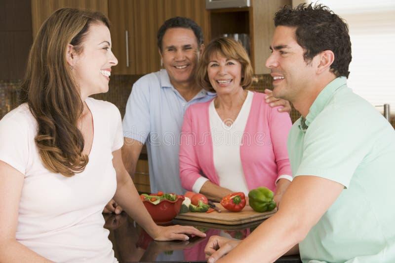 family meal preparing together στοκ εικόνες