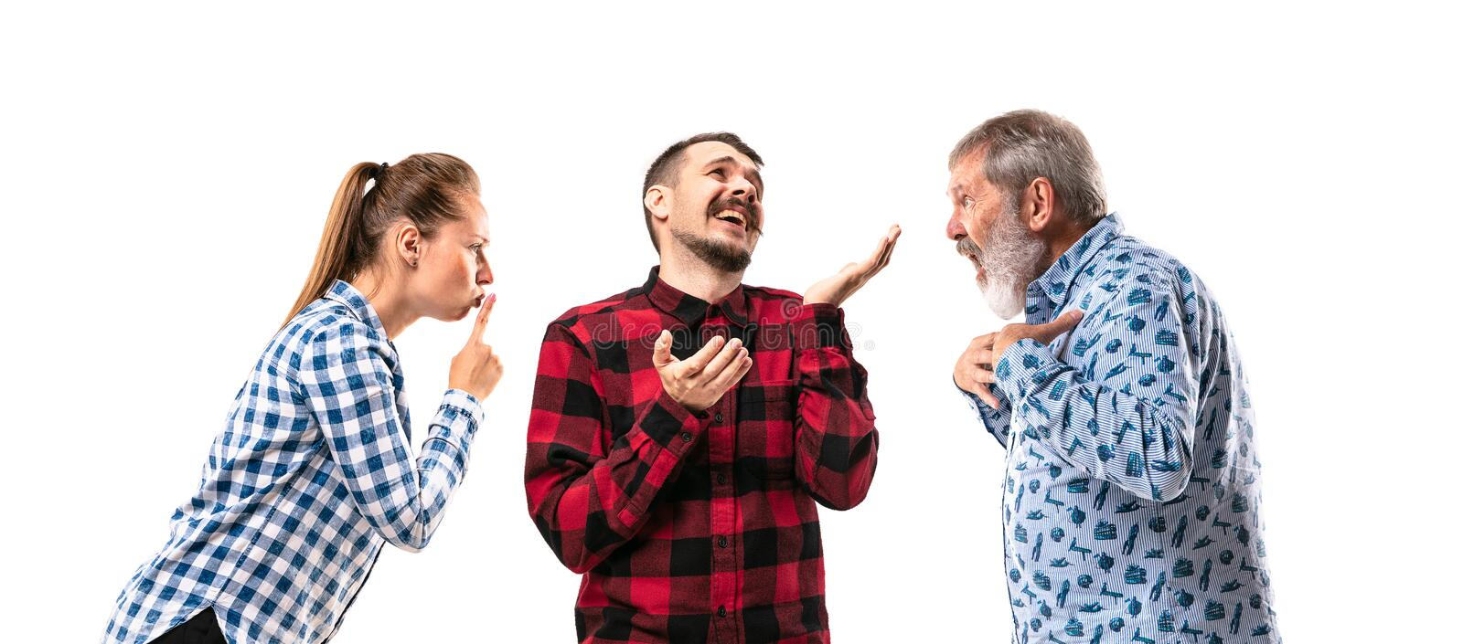 Family members arguing with one another on white studio background. stock images