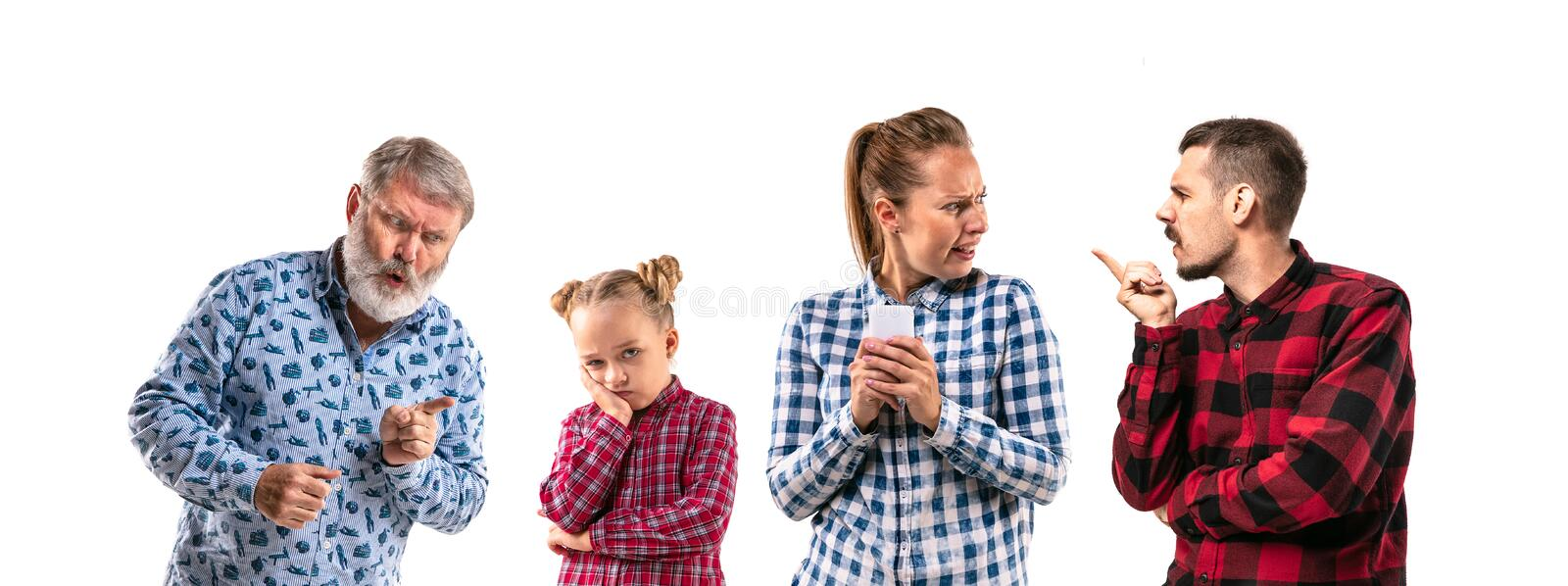 Family members arguing with one another on white studio background. royalty free stock photography