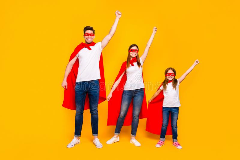 Family members playing cartoon incredible characters protecting world wear superhero flying coats isolated yellow. Family members playing, cartoon incredible royalty free stock image