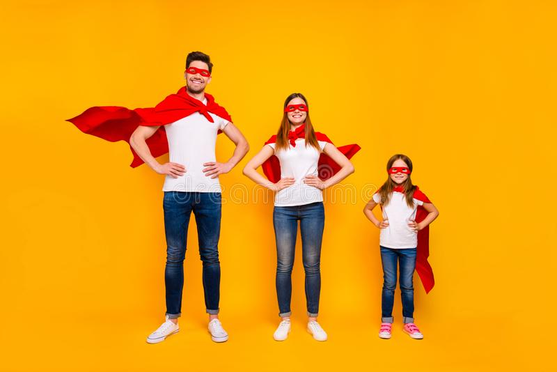 Family members playing cartoon incredible characters wear superhero flying coats isolated yellow background. Family members playing cartoon, incredible royalty free stock photos