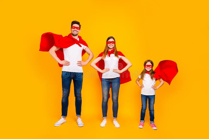 Family members playing cartoon incredible characters wear superhero flying coats isolated yellow background. Family members playing, cartoon incredible royalty free stock image