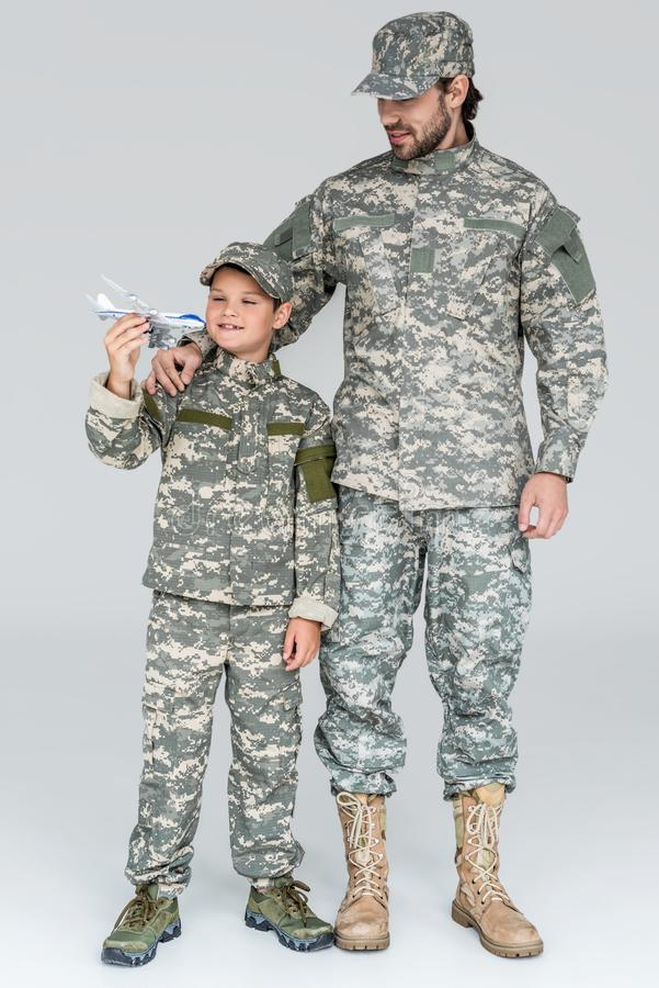 family in military uniform with toy plane stock photo