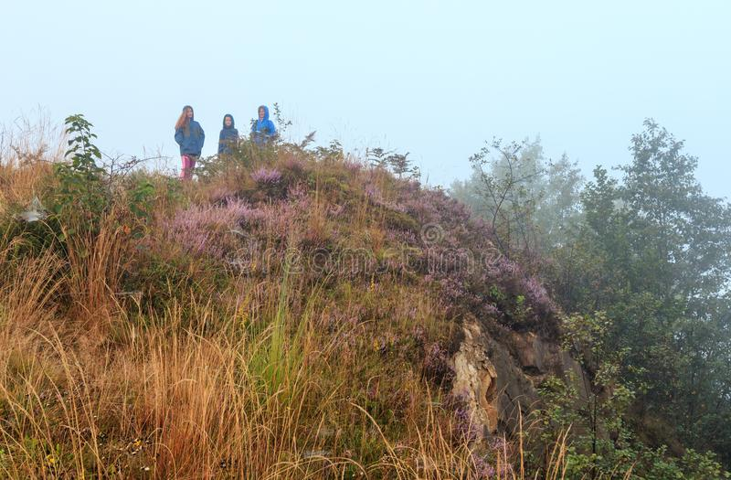 Family on misty morning dew mountain hill. royalty free stock photo