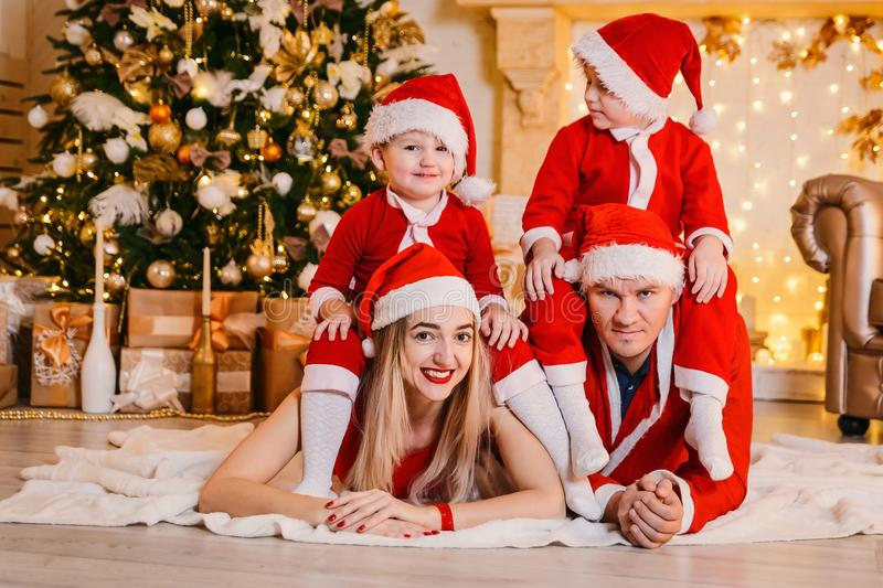 Family of mom, dad and two children for Christmas stock photo