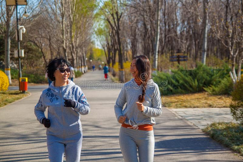 A Family, mother and daughter runner outdoors. royalty free stock photography