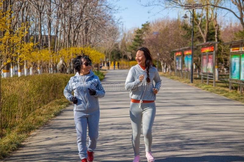 A Family, mother and daughter runner outdoors. royalty free stock image