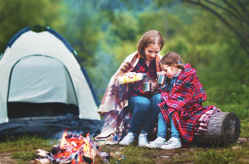 Family mother and child daughter drinking tea on a camping trip stock photography