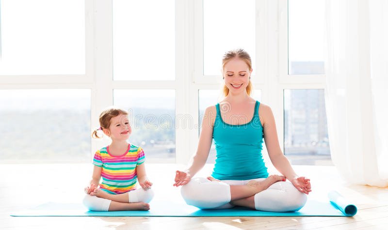 Family mother and child daughter are engaged in meditation and y stock image