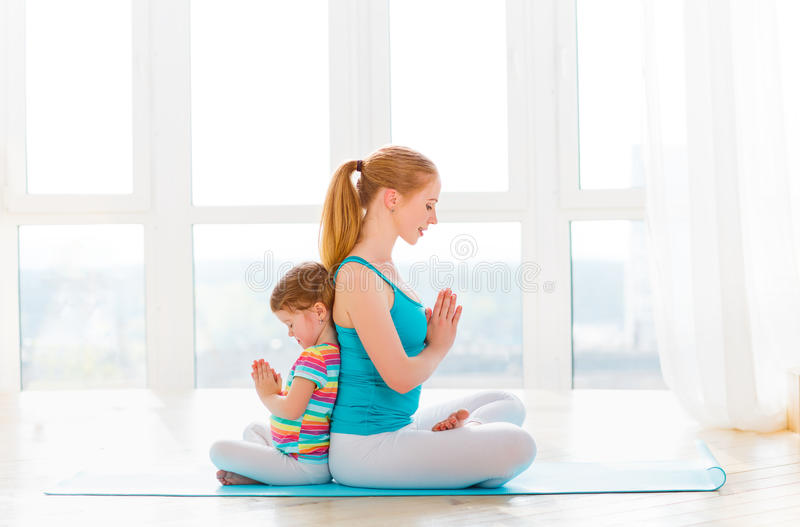 Family mother and child daughter are engaged in meditation and y royalty free stock photo
