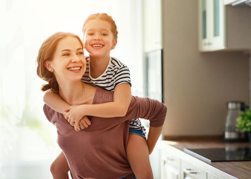 Family mother and child daughter hugging in kitchen. Happy mother`s day! family mother and child daughter hugging in kitchen stock photo