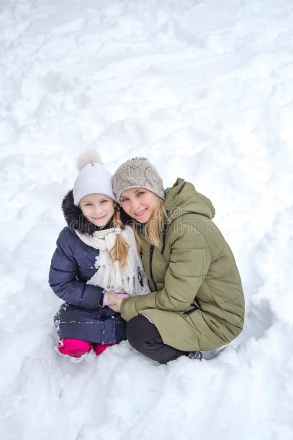 Family mother and child girl on winter walk in nature royalty free stock image