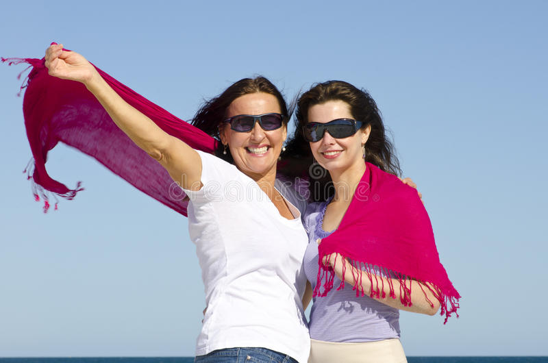 Family mother and daughter happy at ocean royalty free stock photography