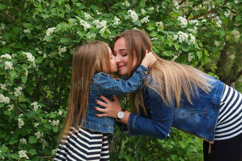 Family. Mother and daughter. Hugs and kisses stock photo