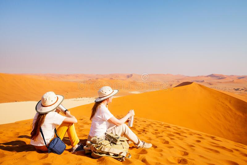 Family on red sand dune royalty free stock photos