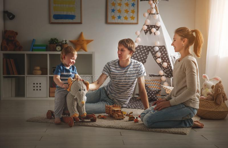 Family mother father and son playing together in children`s pl royalty free stock photo