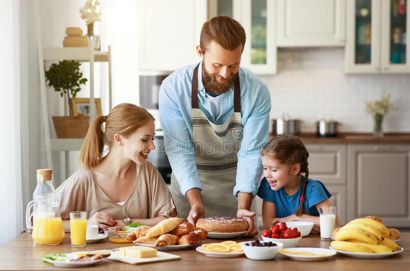 Family mother father and child daughter have Breakfast in kitchen in morning. Family mother father and child daughter have Breakfast in the kitchen in morning stock images