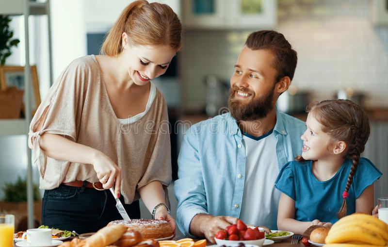 Family mother father and child daughter have Breakfast in kitchen in morning. Family mother father and child daughter have Breakfast in the kitchen in morning stock image