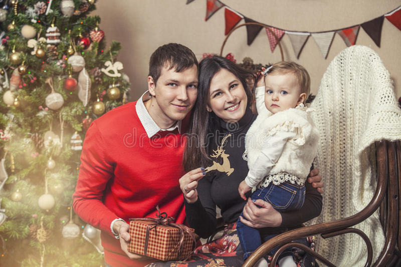 Family mother father and children with gifts in the Christmas in royalty free stock images