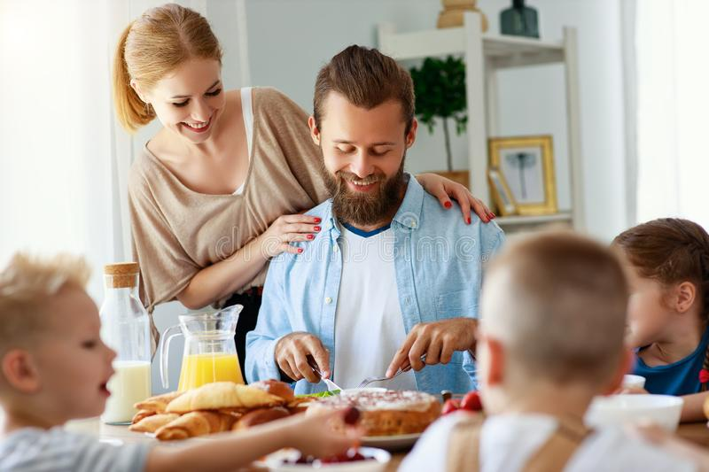 Family mother father and children have Breakfast in kitchen in morning royalty free stock images