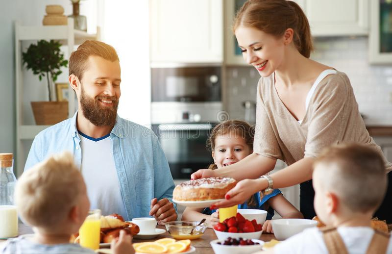 Family mother father and children have Breakfast in kitchen in morning stock photos