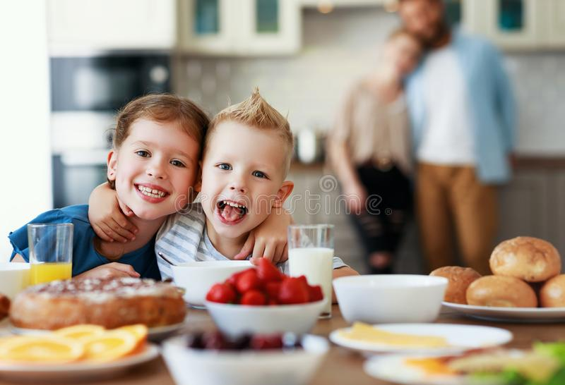 Family mother father and children have Breakfast in kitchen in morning. Family mother father and children have Breakfast in the kitchen in morning royalty free stock photo
