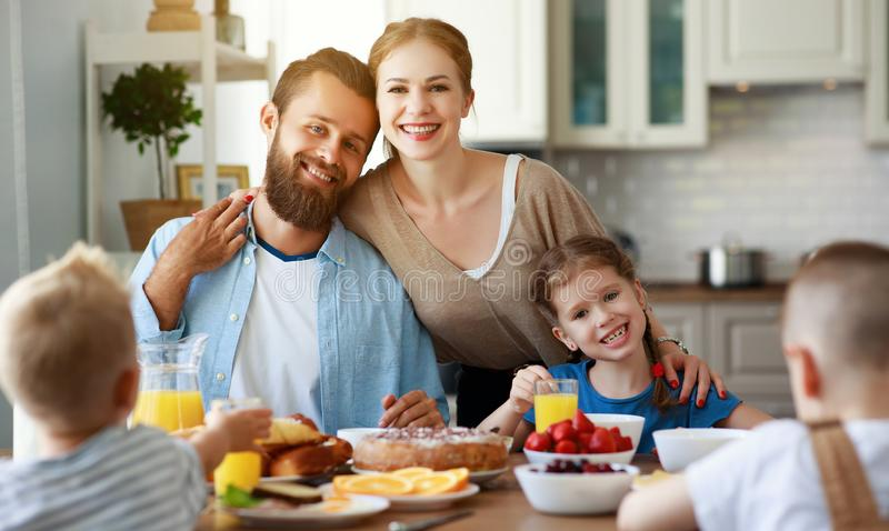 Family mother father and children have Breakfast in kitchen in morning. Family mother father and children have Breakfast in the kitchen in morning stock photo