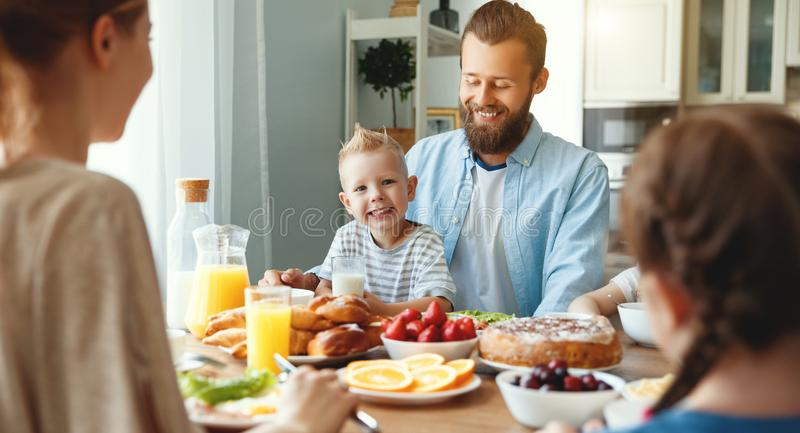Family mother father and children have Breakfast in kitchen in morning royalty free stock photos