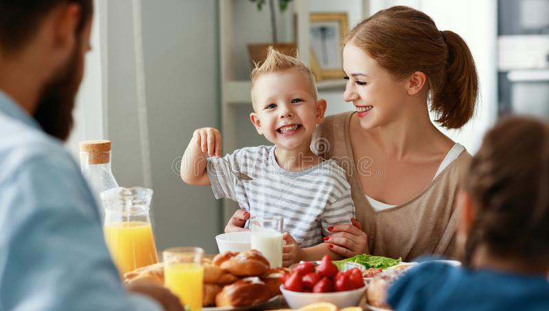 Family mother father and children have Breakfast in kitchen in morning stock images