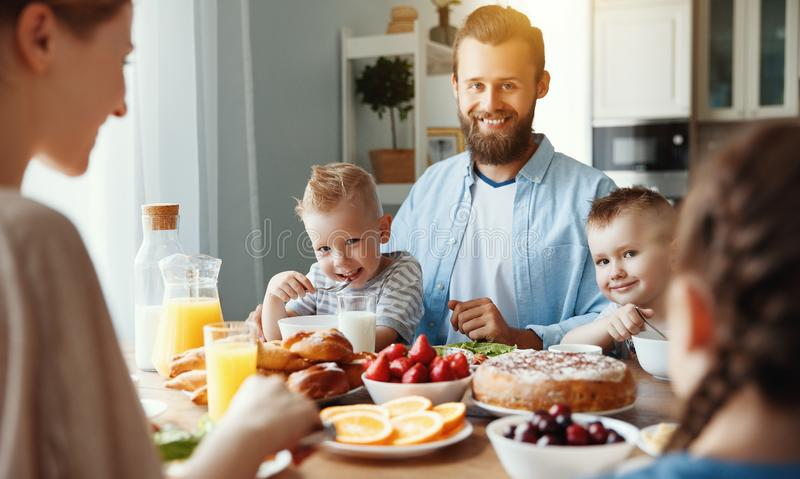 Family mother father and children have Breakfast in kitchen in morning stock image