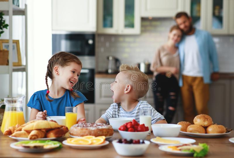 Family mother father and children have Breakfast in kitchen in morning. Family mother father and children have Breakfast in the kitchen in morning royalty free stock photos