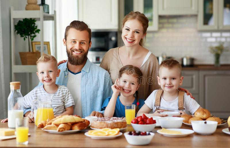 Family mother father and children have Breakfast in kitchen in morning. Family mother father and children have Breakfast in the kitchen in morning stock photography