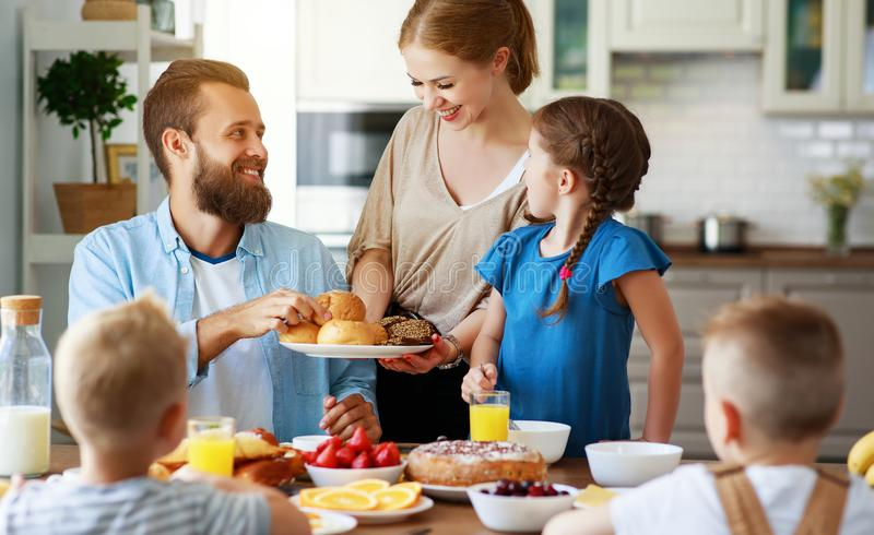 Family mother father and children have Breakfast in kitchen in morning. Family mother father and children have Breakfast in the kitchen in morning royalty free stock photography
