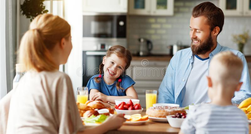 Family mother father and children have Breakfast in kitchen in morning stock photography