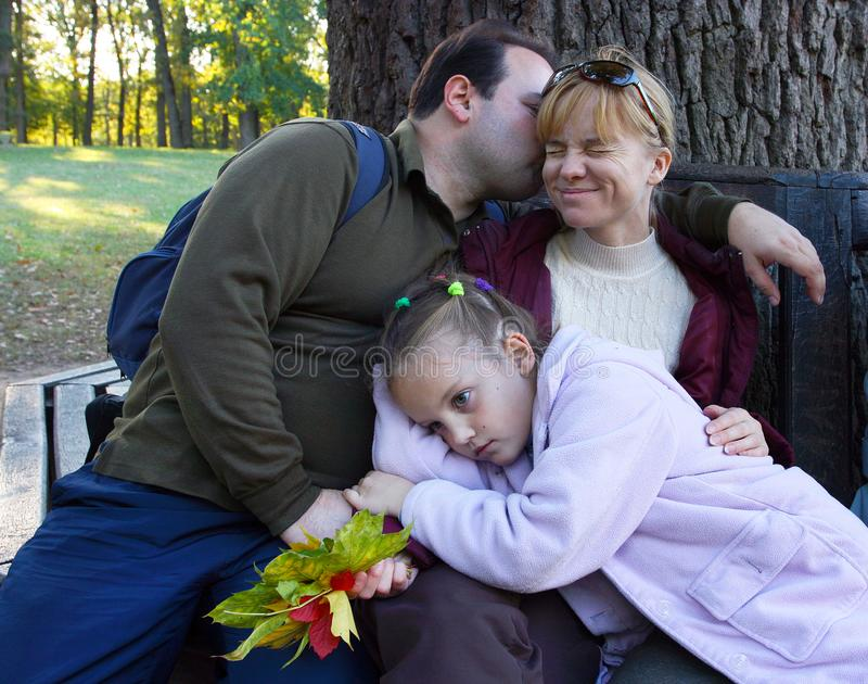 Family - mother, father and daughter - is resting outdoors royalty free stock photo