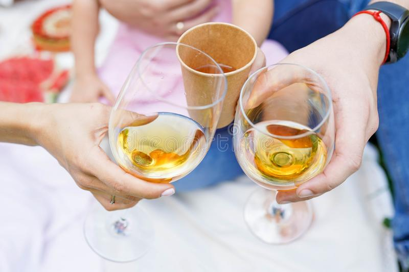 Family mother, father and doughter clinking with glasses of wine stock photography