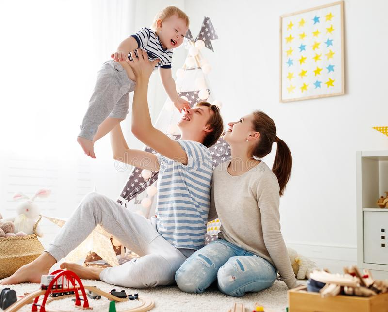 Family mother father and son playing together in children`s pl stock images