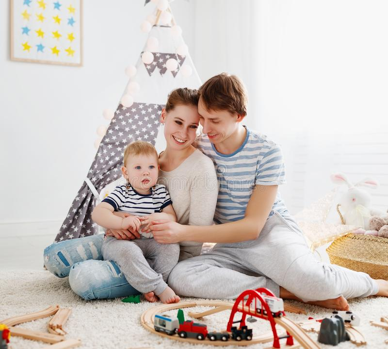 Family mother father and son playing together in children`s pl stock photo