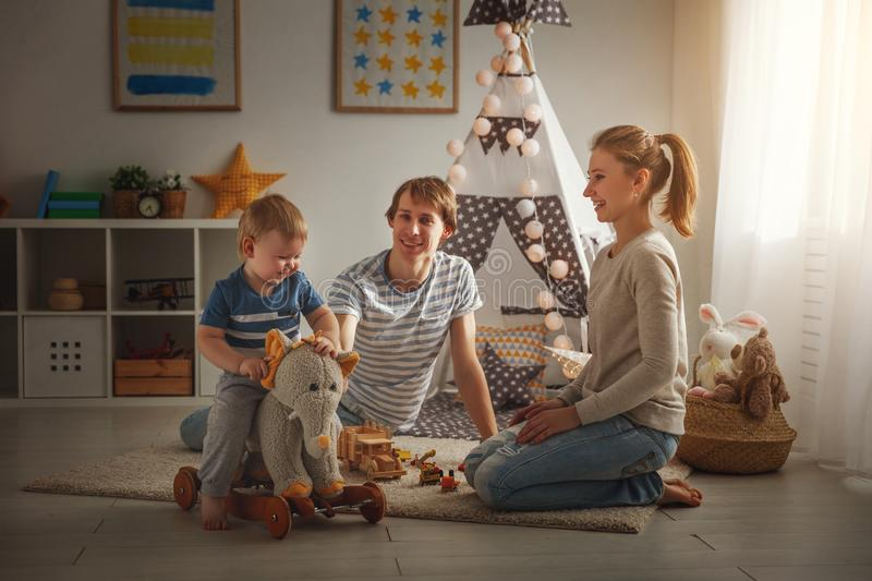 Family mother father and son playing together in children`s pl stock photos