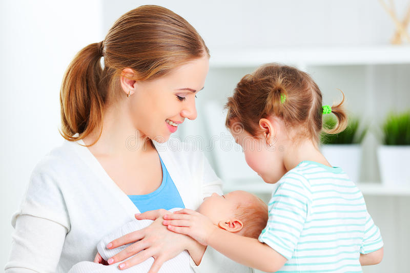 Family. mother, newborn baby and big sister. Happy family. mother, newborn baby and big sister stock photography