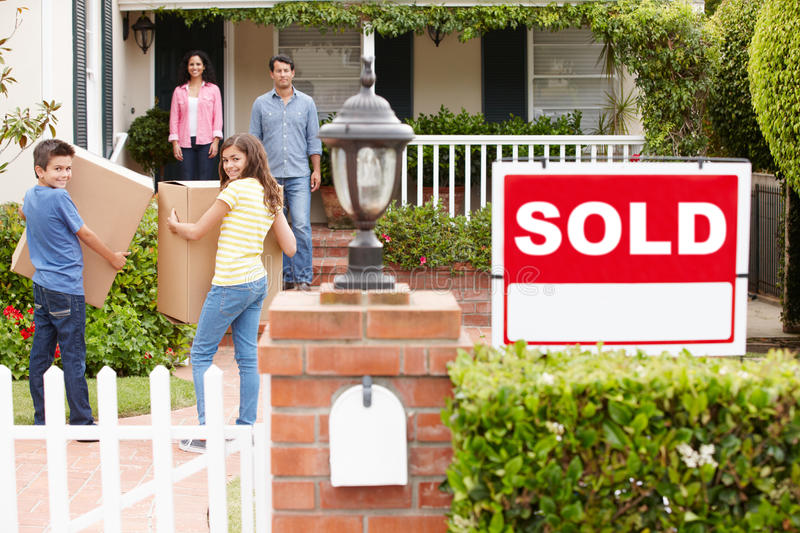 Download Family Moving Into New Home Stock Photo - Image: 21156860