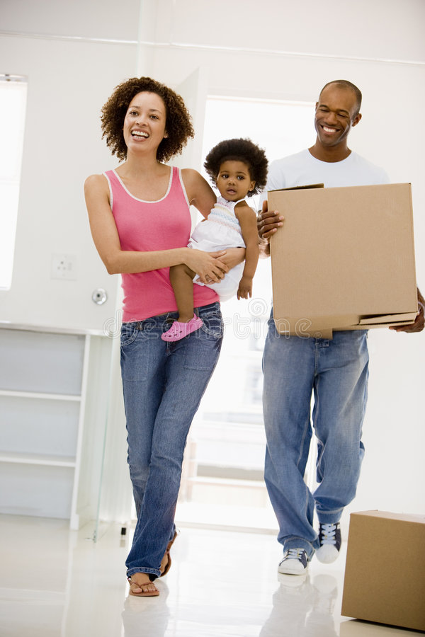 Download Family Moving Into New Home Smiling Stock Image - Image: 5942773