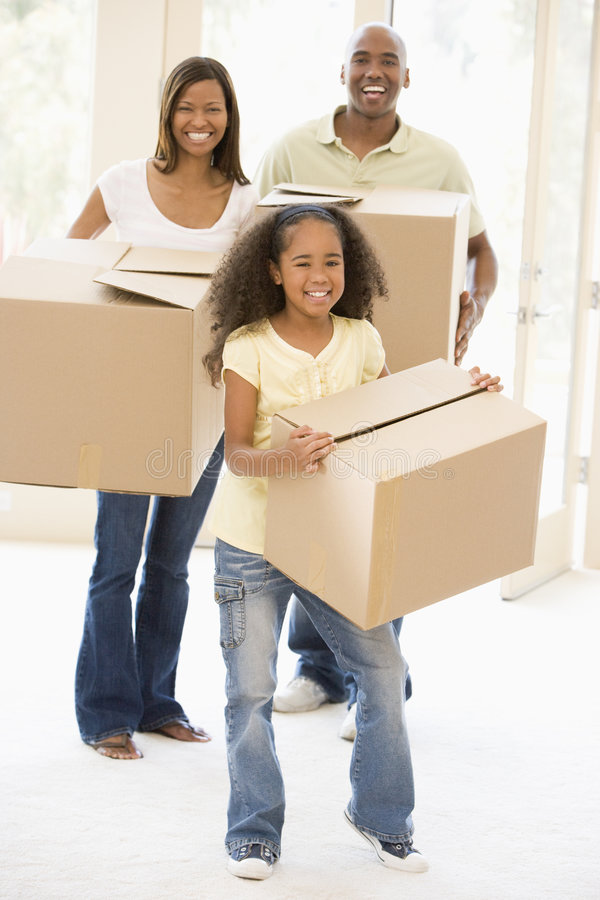 Family moving into new home smiling stock photo