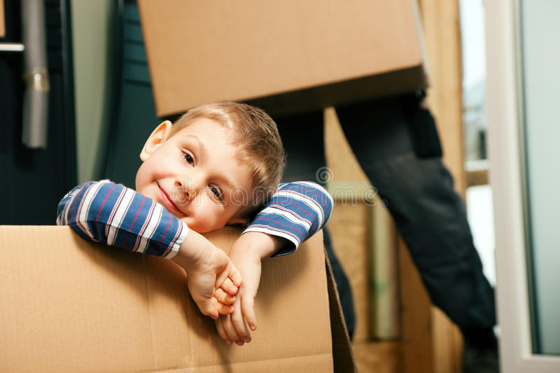 Family moving in their new house stock photography