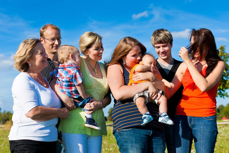 Family and multi-generation - fun on meadow in summer. Family and multi-generation - mother, father, children and grandmother having fun on meadow in summer stock photos